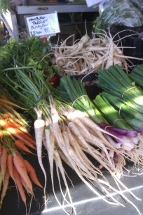 Carrots, Hambug parsley and salad onions for sale at the market